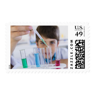 Student doing science experiment 3 stamp