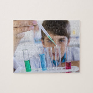 Student doing science experiment 3 puzzles