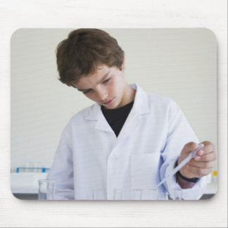 Student doing science experiment 4 mouse pad