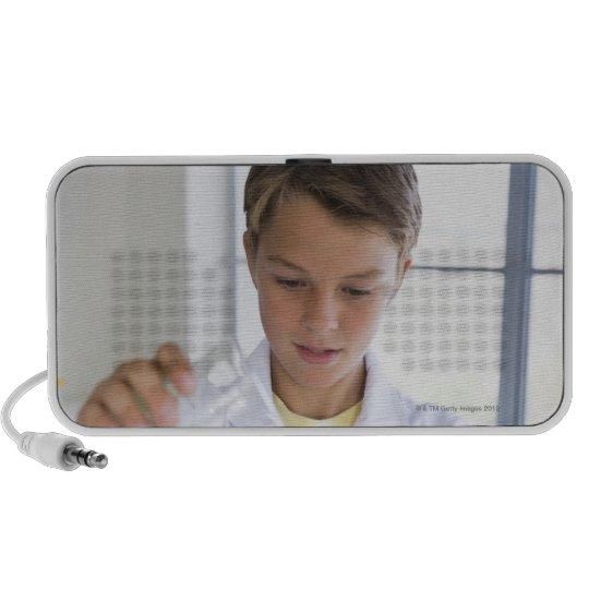 Student doing science experiment 5 portable speaker