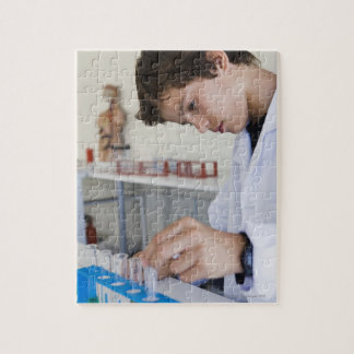 Student doing science experiment puzzles