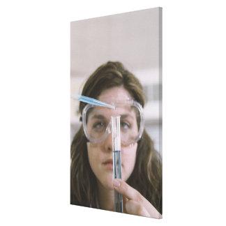 Student Holding Test Tube Canvas Print
