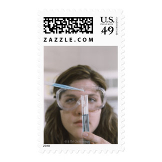 Student Holding Test Tube Postage Stamp