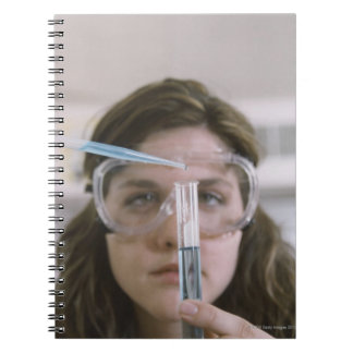 Student Holding Test Tube Spiral Notebook