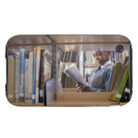 Student in school uniform looks at a book in a iPhone 3 tough cover
