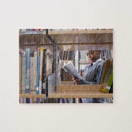 Student in school uniform looks at a book in a puzzle