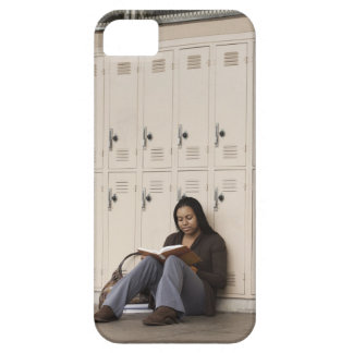 Student leaning on school lockers studying iPhone 5 case
