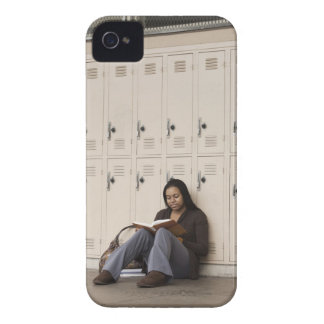 Student leaning on school lockers studying Case-Mate iPhone 4 case