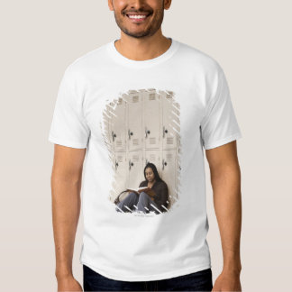 Student leaning on school lockers studying T-Shirt