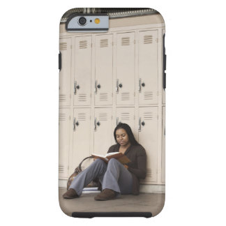Student leaning on school lockers studying tough iPhone 6 case