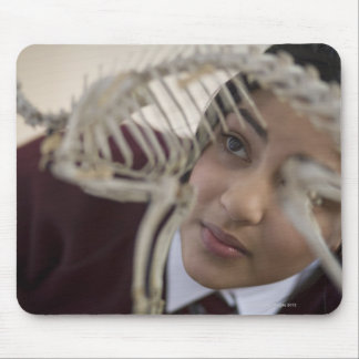 Student looking at animal skeleton mouse pad