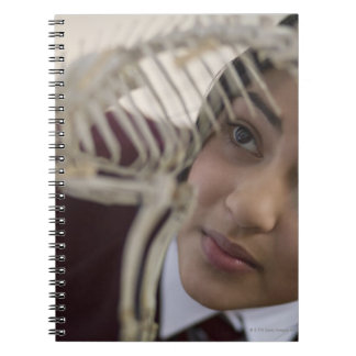 Student looking at animal skeleton spiral notebook