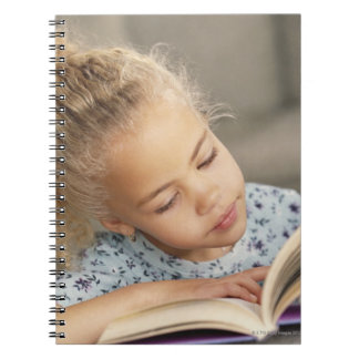 Student reading notebook