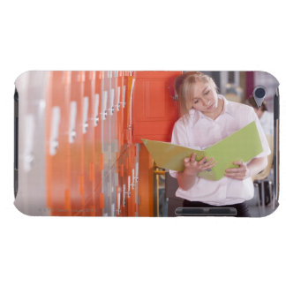 Student removing binder from school locker barely there iPod case