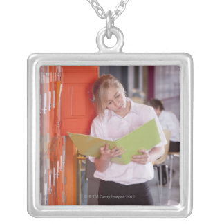 Student removing binder from school locker silver plated necklace
