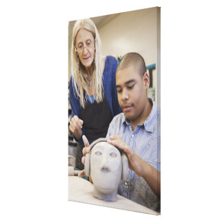Student sculpting bust in classroom gallery wrapped canvas