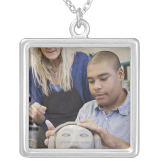 Student sculpting bust in classroom silver plated necklace