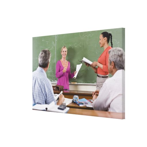 Student talking to class and standing by teacher canvas print