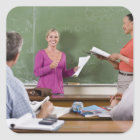 Student talking to class and standing by teacher square sticker