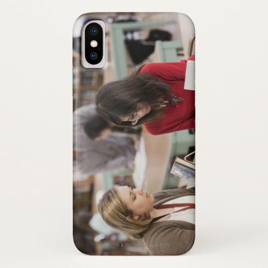 Student talking to librarian in school library blackberry bold case