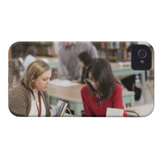 Student talking to librarian in school library iPhone 4 case