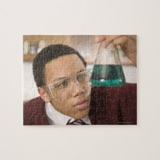 Student watching chemistry experiment puzzles