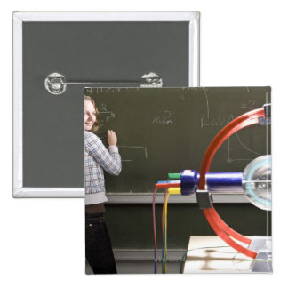 Student writing on blackboard button