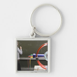 Student writing on blackboard Silver-Colored square keychain