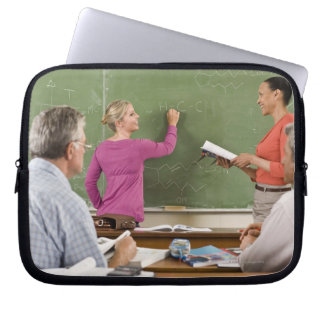 Students and teacher in classroom computer sleeve