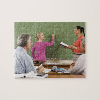 Students and teacher in classroom jigsaw puzzle