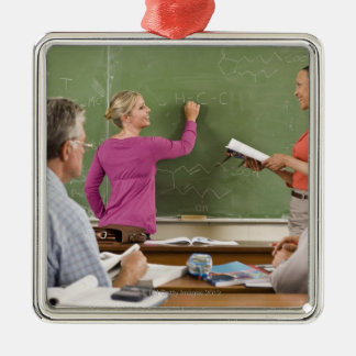 Students and teacher in classroom metal ornament