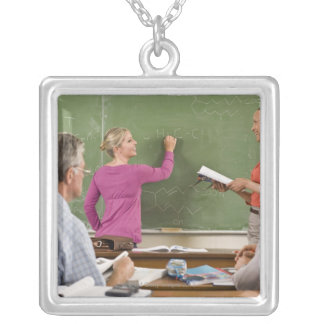 Students and teacher in classroom silver plated necklace