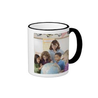 students and teacher with globe ringer coffee mug