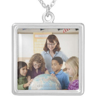 students and teacher with globe silver plated necklace