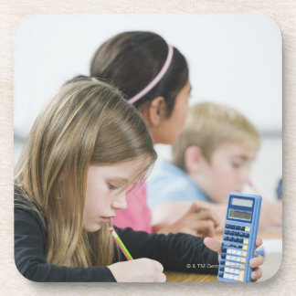 Students doing math work in classroom beverage coaster