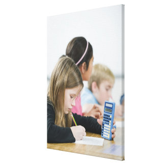 Students doing math work in classroom canvas print