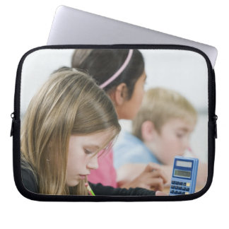 Students doing math work in classroom computer sleeve
