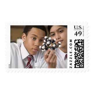 Students looking at molecular model postage stamp
