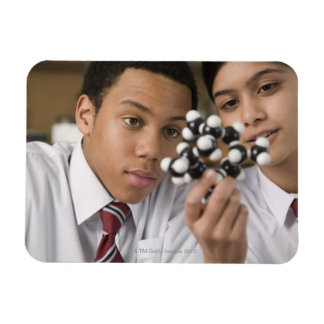 Students looking at molecular model rectangular photo magnet