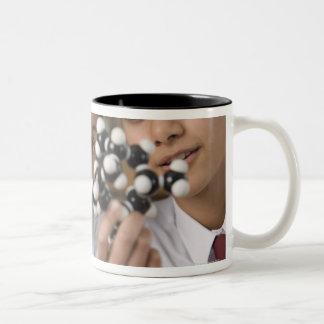 Students looking at molecular model Two-Tone coffee mug