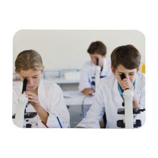 Students looking through microscopes rectangle magnet