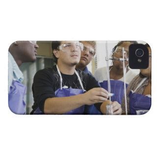 Students performing experiment in chemistry lab iPhone 4 case