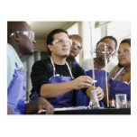 Students performing experiment in chemistry lab postcard