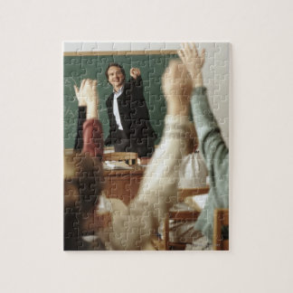 Students raising their hands in classroom jigsaw puzzle