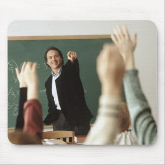 Students raising their hands in classroom mouse pad