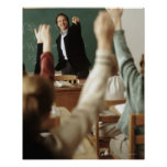 Students raising their hands in classroom print