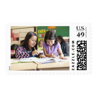 Students working together in classroom postage