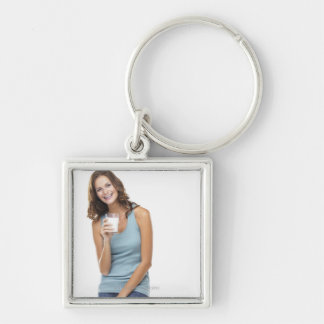 Studio portrait of attractive young woman keychain