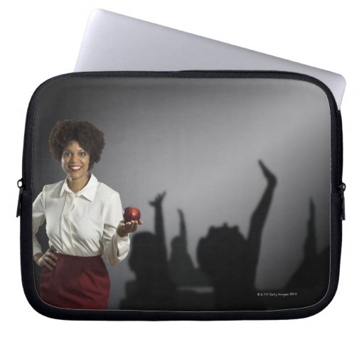Studio portrait of female teacher with shadows laptop sleeve