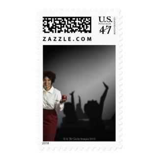 Studio portrait of female teacher with shadows postage stamp